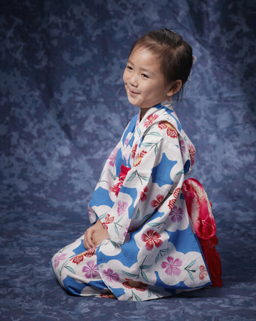 Yukata girl smiling by sitting straight sideways