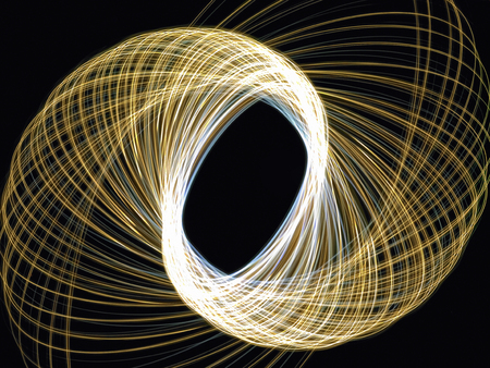 Light traces of pen lights draw a curve