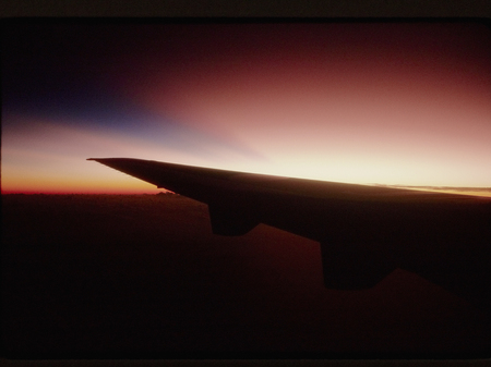 other side of: Morning sun coming up from the other side of the wing