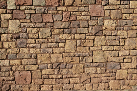 has been: Wall of the building that has been assembled in stone
