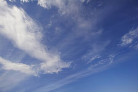 intersects: White cloud that intersects the thin muscle clouds Stock Photo
