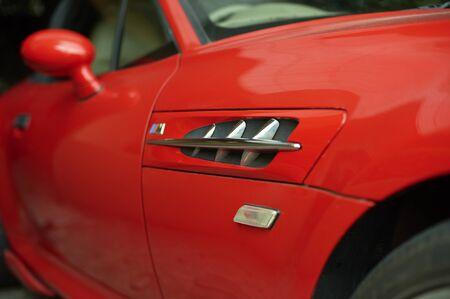 intake: Red car wearing a racing dynamic of the intake