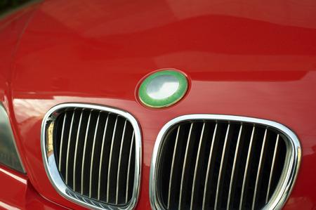 braking: Racing dynamic of bonnet engine braking of the red car Stock Photo