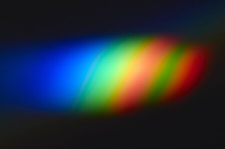 refraction of light: Seven colors of the rainbow that jumped in a room in the refraction of the glass