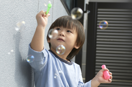 young fellow: Boy of three-year-old is playing with soap bubble