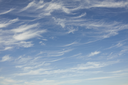 Hook-like cirrus clouds which appeared clearly in blue sky Stock Photo