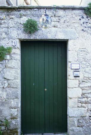 green door: Stone walls and green door