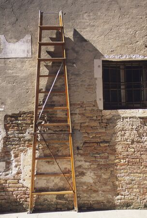 stepladder: Old walls and the stepladder Stock Photo