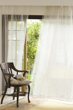 椅子とカーテン 写真素材