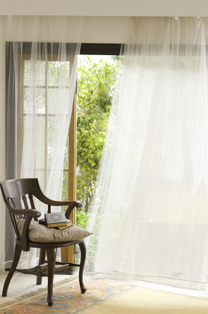 curtain window: Chair and curtains Stock Photo