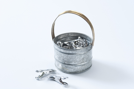 tin cans: Clothespin and tin cans