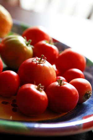 irregularity: fruit of the tomato that was piled on the harvest has been dish