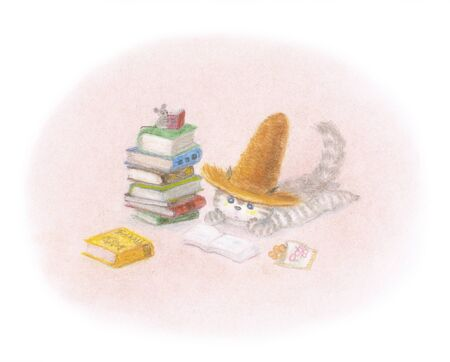 Autumn Cat reading wearing a straw hat Stock Photo