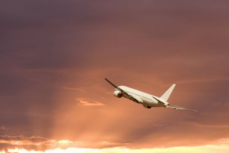 breaking off: Morning glow and airliner Stock Photo