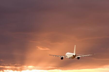 airliner: Morning glow and airliner Stock Photo
