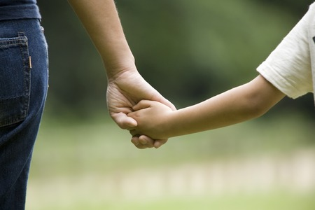 adult hand: Holding Hands mother and child