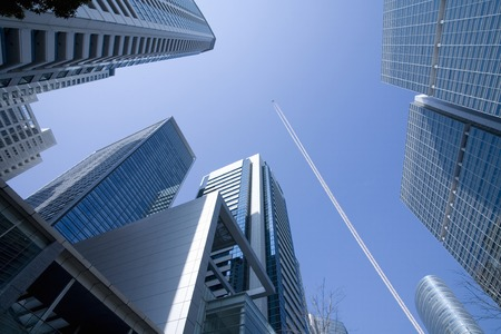 contrail: High-rise building and contrail