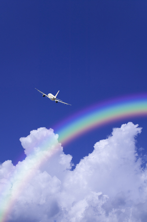 thundercloud: Planes and thunderhead and rainbow Stock Photo