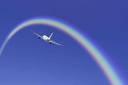 airliner: Airliner and rainbow Stock Photo