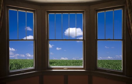 sunroom: Grassland and clouds from the window Stock Photo