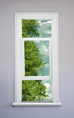 sunroom: Fresh green and river from white window Stock Photo