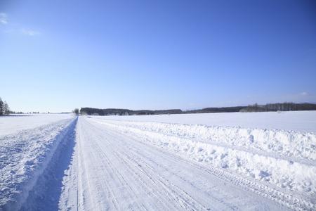 straight path: Snowy road Stock Photo