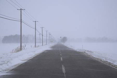 road in winter: Winter road and snowstorm Archivio Fotografico