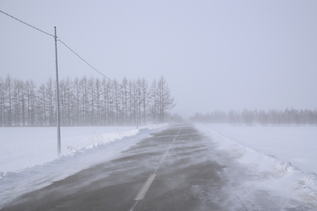 winter road: Winter road and snowstorm Stock Photo