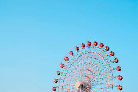 pleasent: Blue sky and red Ferris wheel
