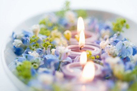 Aroma candle and blue flowers