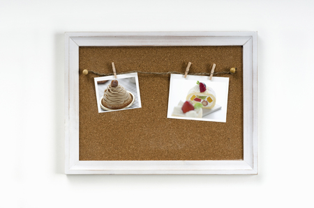 affixed: Cake photo of it is affixed to the corkboard Stock Photo