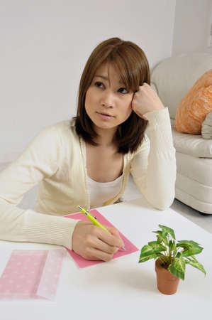 person woman: Lady writing a letter