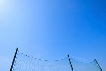 pleasent: Blue sky and backstop