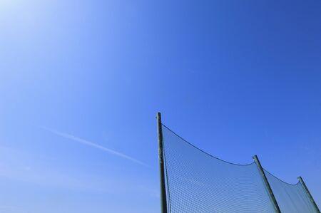 backstop: Blue sky and backstop