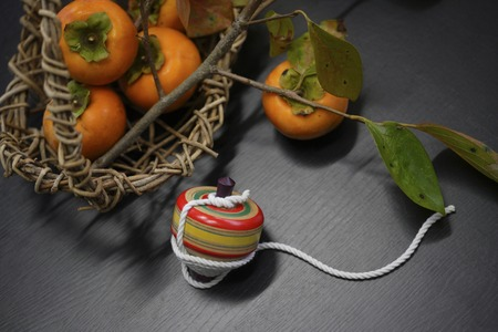 oyster plant: Persimmon and Japanese toys Stock Photo
