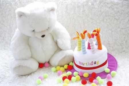 誕生日ケーキとテディベア 写真素材