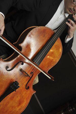 cellos: Cellist Stock Photo