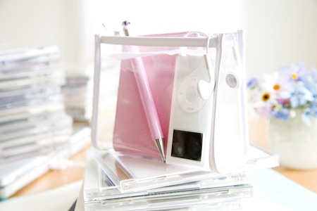 daily room: Pink Notepad and CD Stock Photo