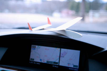 car navigation: Car navigation system and a paper airplane