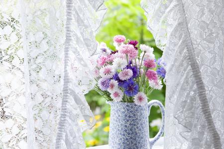windowsill: Windowsill of cornflower flowers Stock Photo