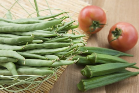 bean family: Green beans and okra and tomatoes Stock Photo
