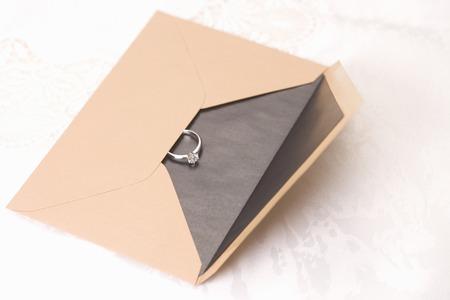 Diamond ring and envelopes Stok Fotoğraf