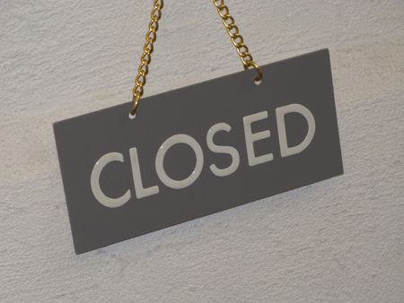 over the counter: Closed display board