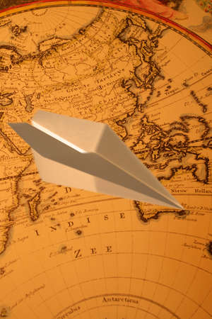 synthesis: Synthesis of paper airplanes and the world map Stock Photo