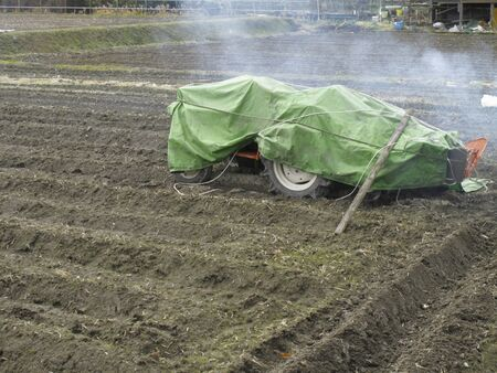 cultivator: Cultivator that was covered with a sheet