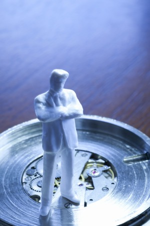 scaled down: Watch and figure Stock Photo