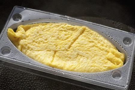 frozen food: Water bath thawing of frozen food Stock Photo