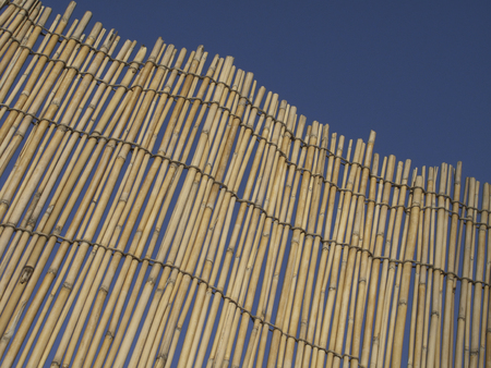 awnings: and leaning against the reed screen Stock Photo