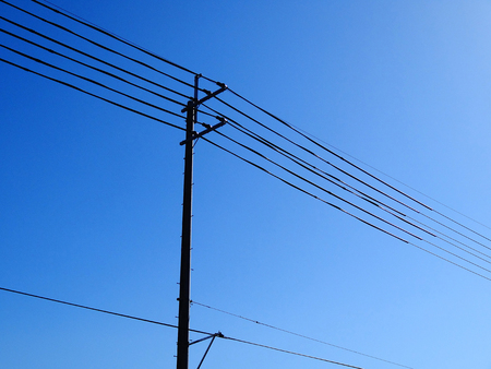 telephone poles: Electric wires and telephone poles Stock Photo