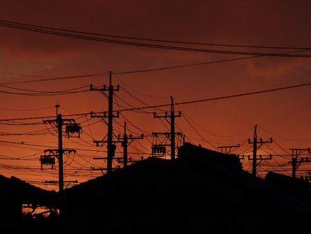 utility pole: Housing and utility pole silhouette